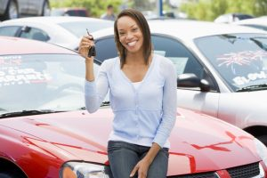 woman holding car key