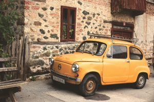 old yellow small car