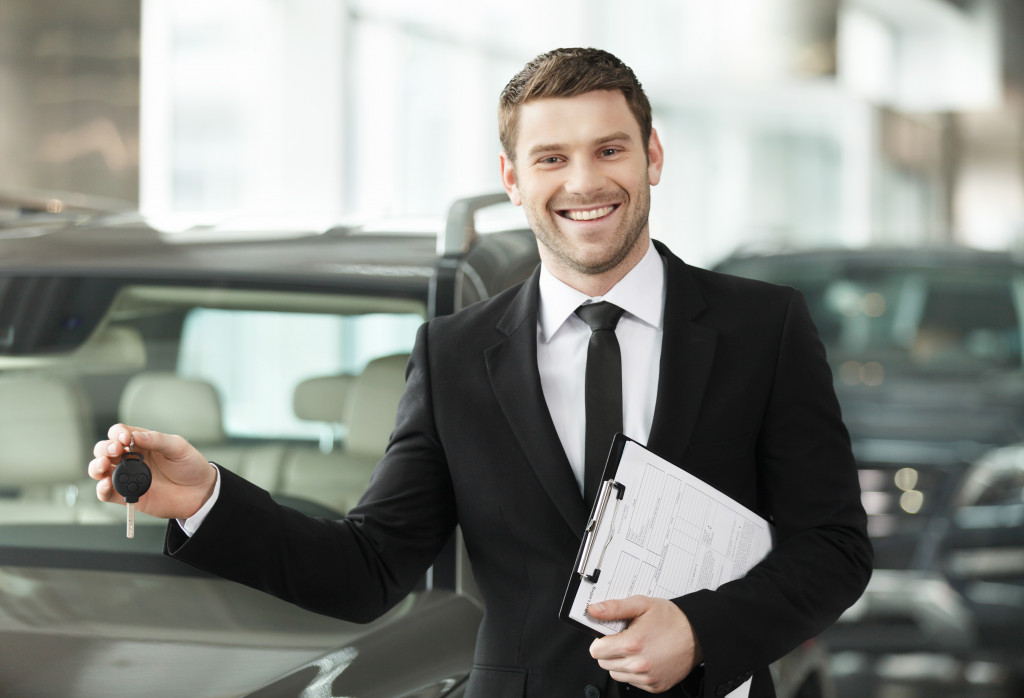 man selling regular cars